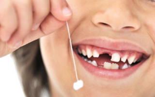 Зуб на нитке