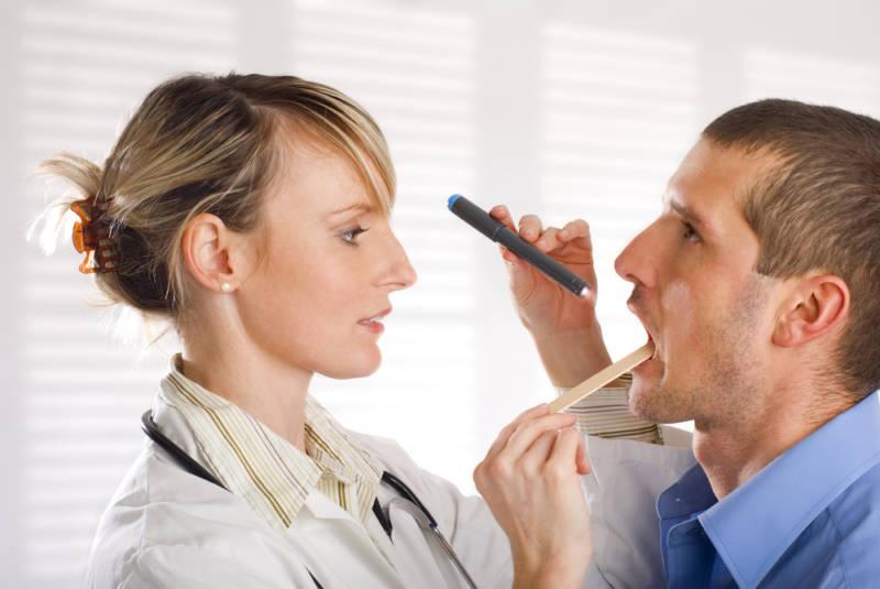 Папиллома во рту на языке: причины, лечение, удаление